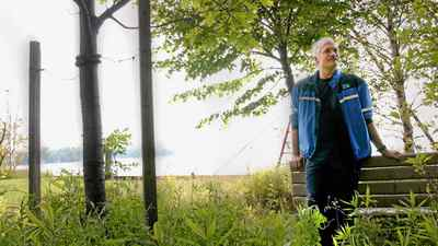 Jack Layton leans on a bench commemorated to his best friend, Dan Leckie, on Algonquin Island.