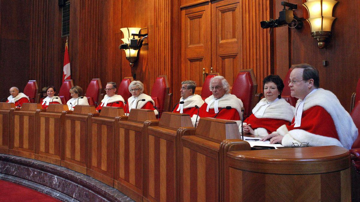Canada's Supreme Court judges look on from the bench during a ceremony welcoming Mr. Justice Thomas Cromwell, right, in Ottawa on Feb. 16, 2009.