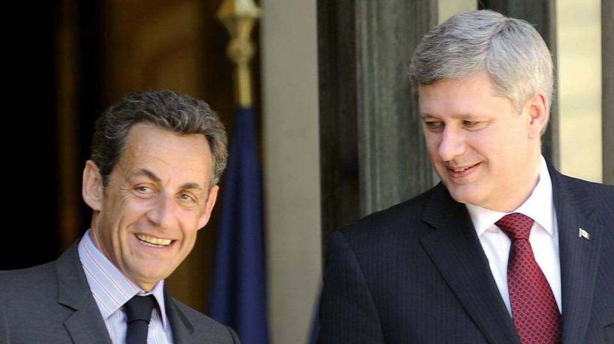 French President Nicolas Sarkozy and Prime Minister Stephen Harper leave the Elysee Palace in Paris on Friday, June 4.