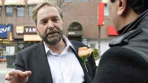 Deputy NDP leader Thomas Mulcair speaks with a supporter while campaigning in Montreal on May 2, 2011.