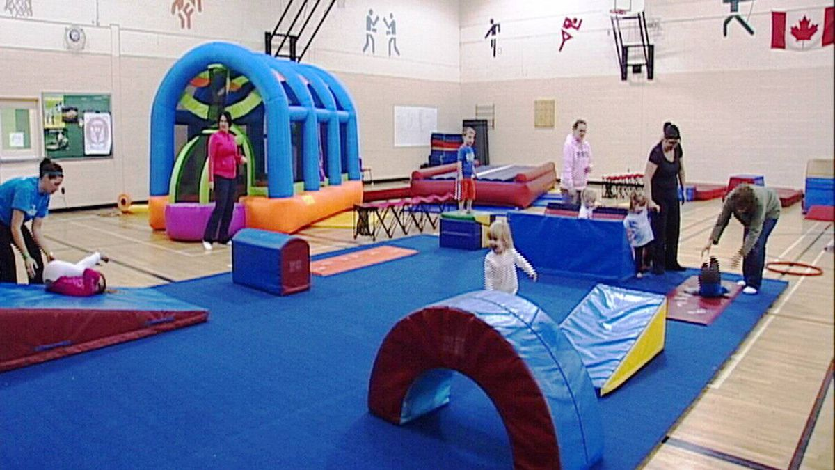 Children under supervision move through an obstacles course in a Go-Go Gymnastics Tumble Tots class.