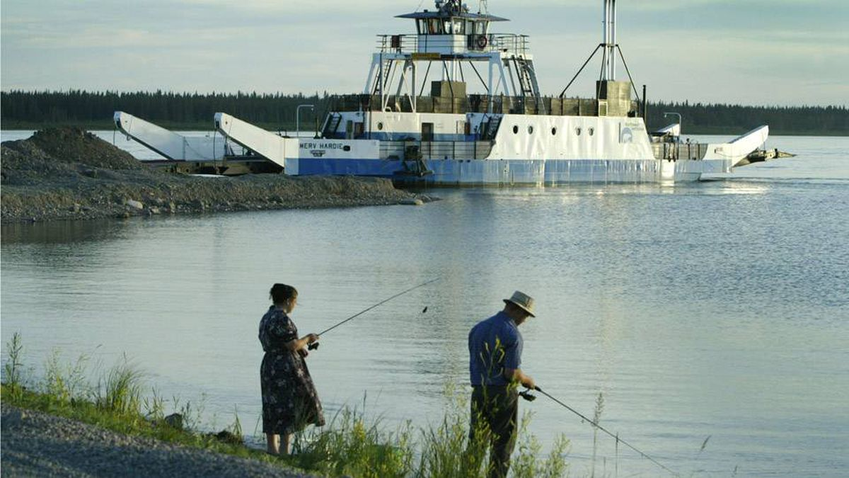 Two people fish on the Mackenzie River in this 2003 photo.New research signals a booming level of dangerous toxins in the river's fish, due to climate change.