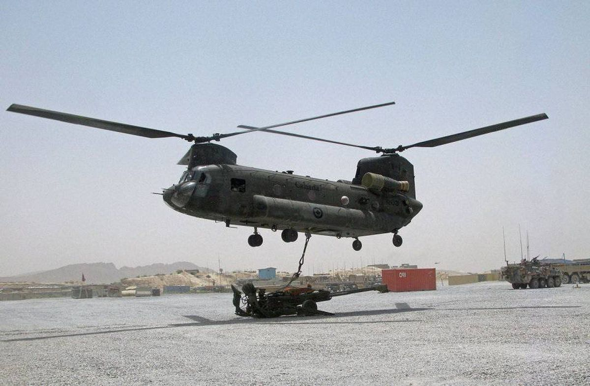A Canadian Chinook helicopter prepares to remove a Howitzer from a forward operating base in the Panjwaii district of Afghanistan on July 9, 2010.