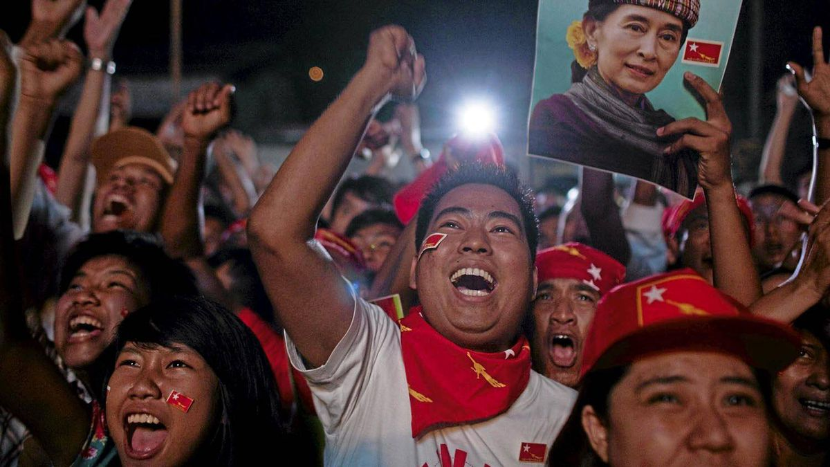 National League for Democracy supporters celebrate outside the NLD headquarters as they watch results come in for the byelections in Yangon, Myanmar