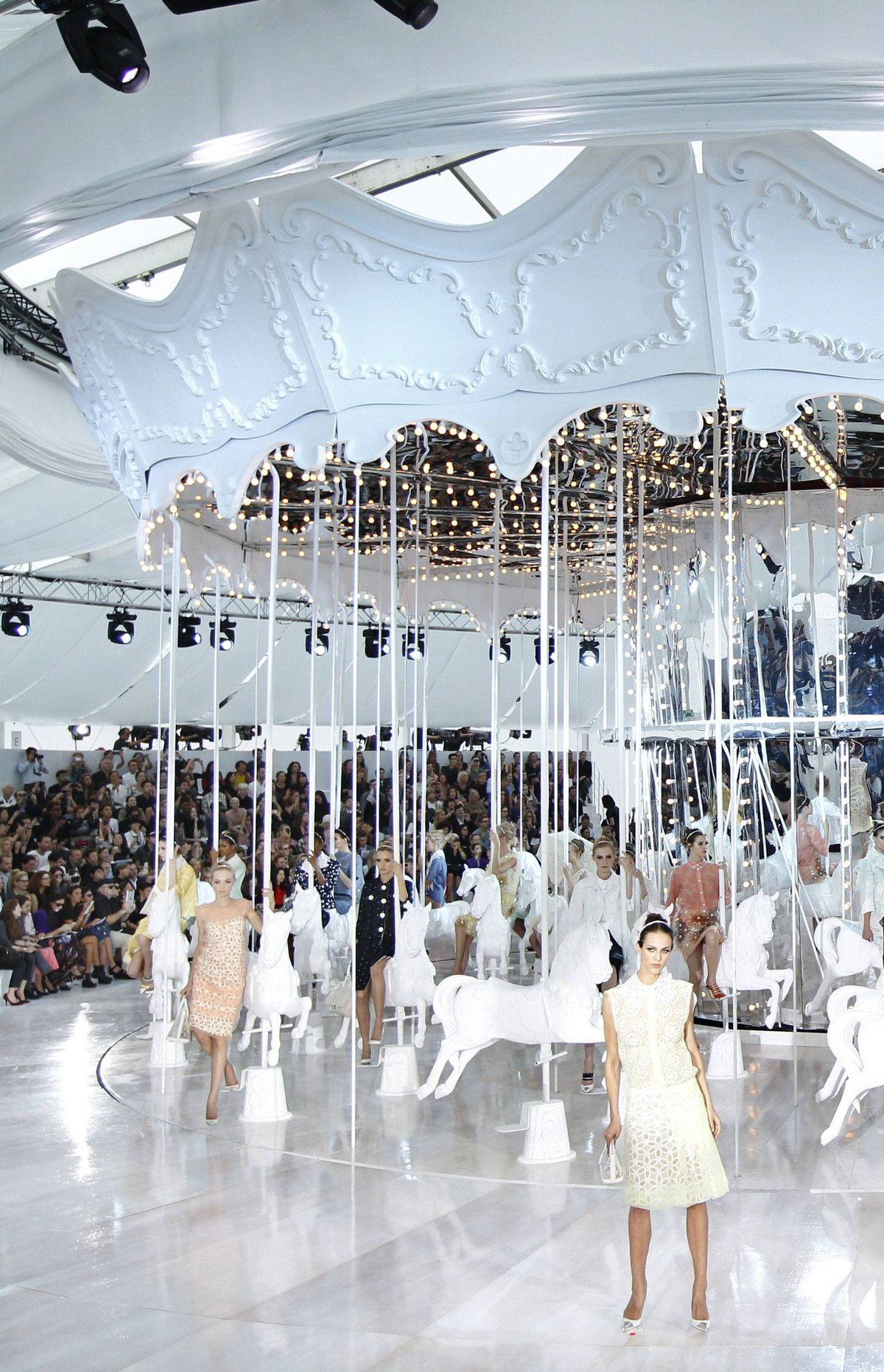Louis Vuitton Spring/Summer 2012 ready-to-wear collection Louis Vuitton has traditionally held the final morning slot of Paris Fashion Week. Unsurprisingly, the maison stages a mega-production. On this occasion, a cylindrical curtain dropped to reveal an all-white, fully functioning carousel. One model to a horse, they gradually stepped off and promenaded around the circular runway.