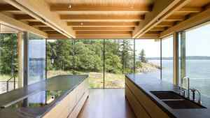 In the Saltspring Island home designed by RUF's Sean Pearson and Alyssa Schwann, interior spaces such as the kitchen are aligned to feel as if they extend into the ocean.