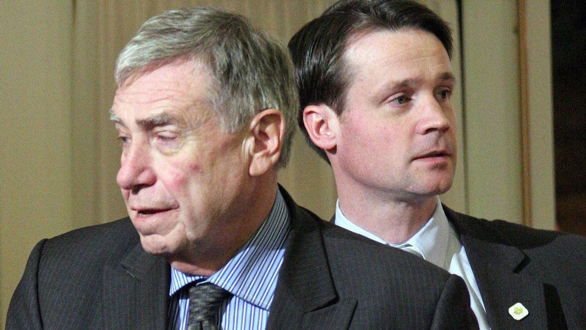 PMO officials Bruce Carson, left, and Mark Cameron are pictured in Ottawa, on Jan. 23, 2007.