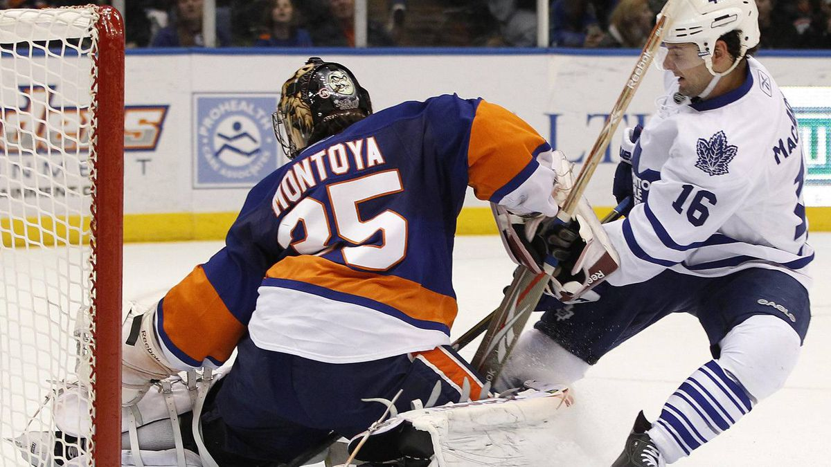 Toronto Maple Leafs Clarke MacArthur (16) puts a shot on goal against the New York Islanders goalie Al Montoya during the first period of their NHL hockey game in Uniondale, New York, March 8, 2011.