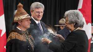A native elder performs a smudging ceremony with Shawn Atleo, national chief of the Assembly of First Nations, and Prime Minister Stephen Harper at the opening of the Crown-First Nations Gathering in Ottawa in January.
