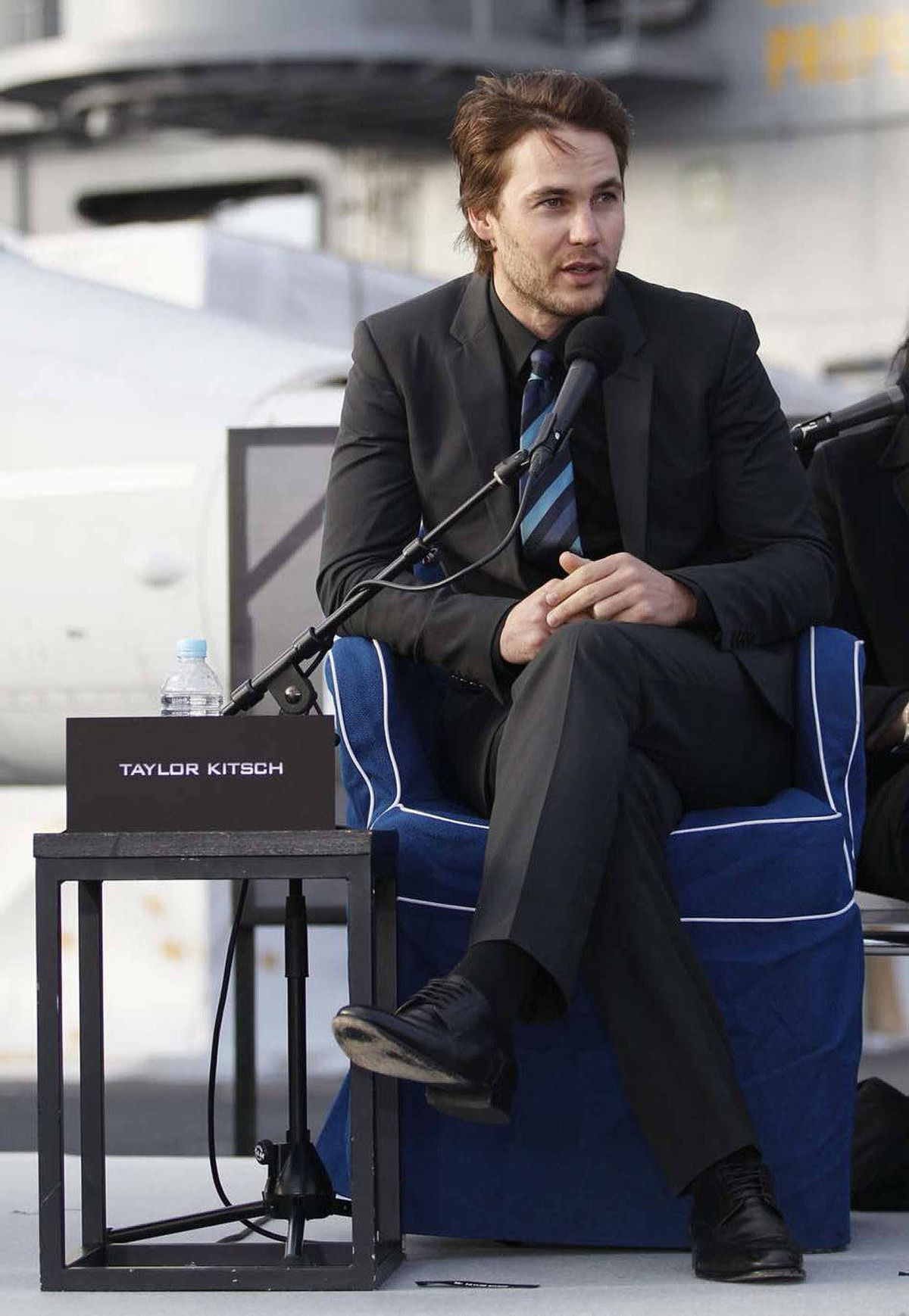 "Canadian actor Taylor Kitsch speaks during a news conference to promote the film ""Battleship"" atop the flight deck of a U.S. aircraft carrier in Tokyo. In the Kingdom of Kitsch, Taylor Kitsch would be related to the ruling family and probably get a cushy civil service job."