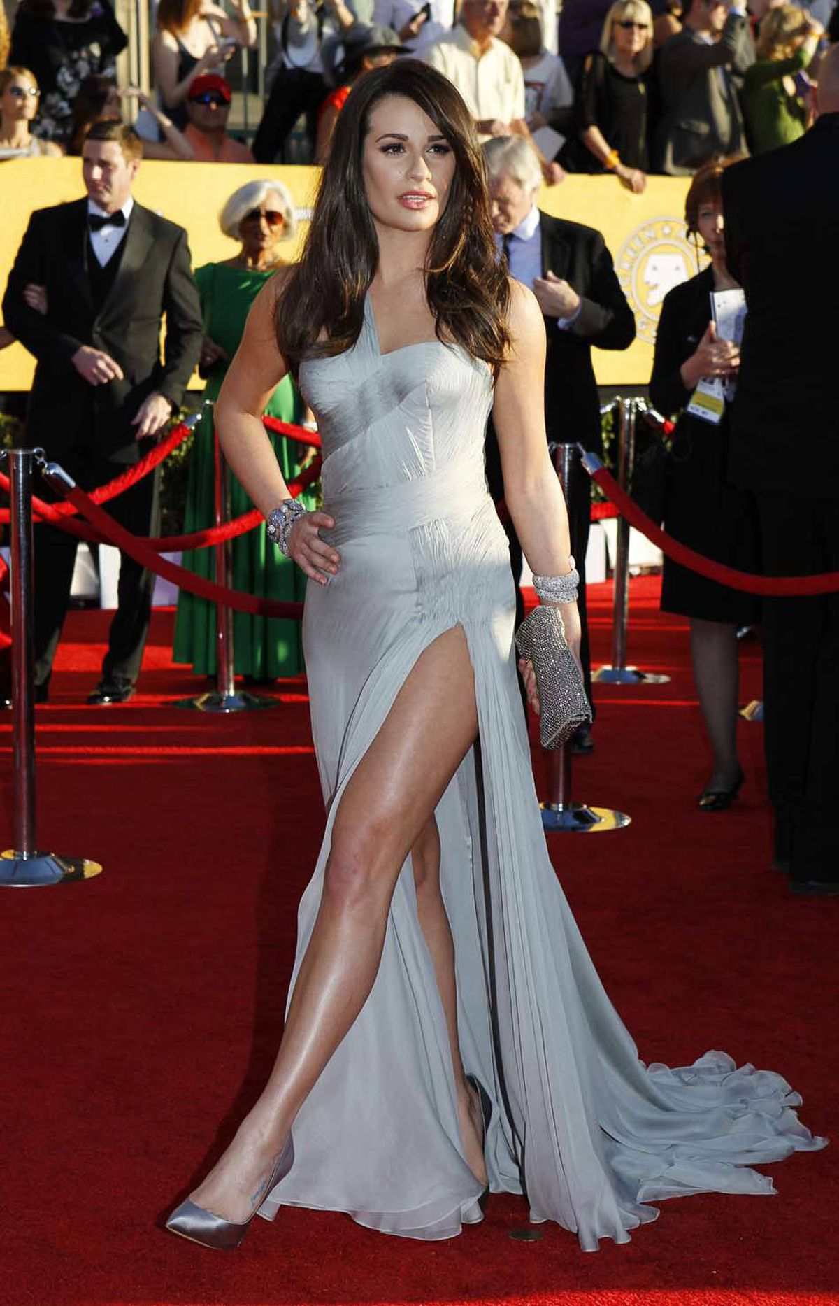 Actress Lea Michele airs out a leg on the red carpet at the SAG awards in Los Angeles Sunday.