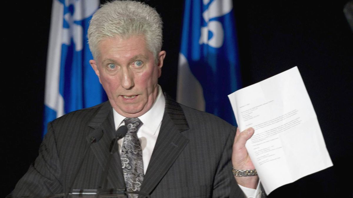 Bloc Québécois Leader Gillles Duceppe waves the 2004 letter signed by him, Conservative Leader Stephen Harper and NDP Leader Jack Layton proposing a coalition government to replace the then-ruling Paul Martin Liberals.