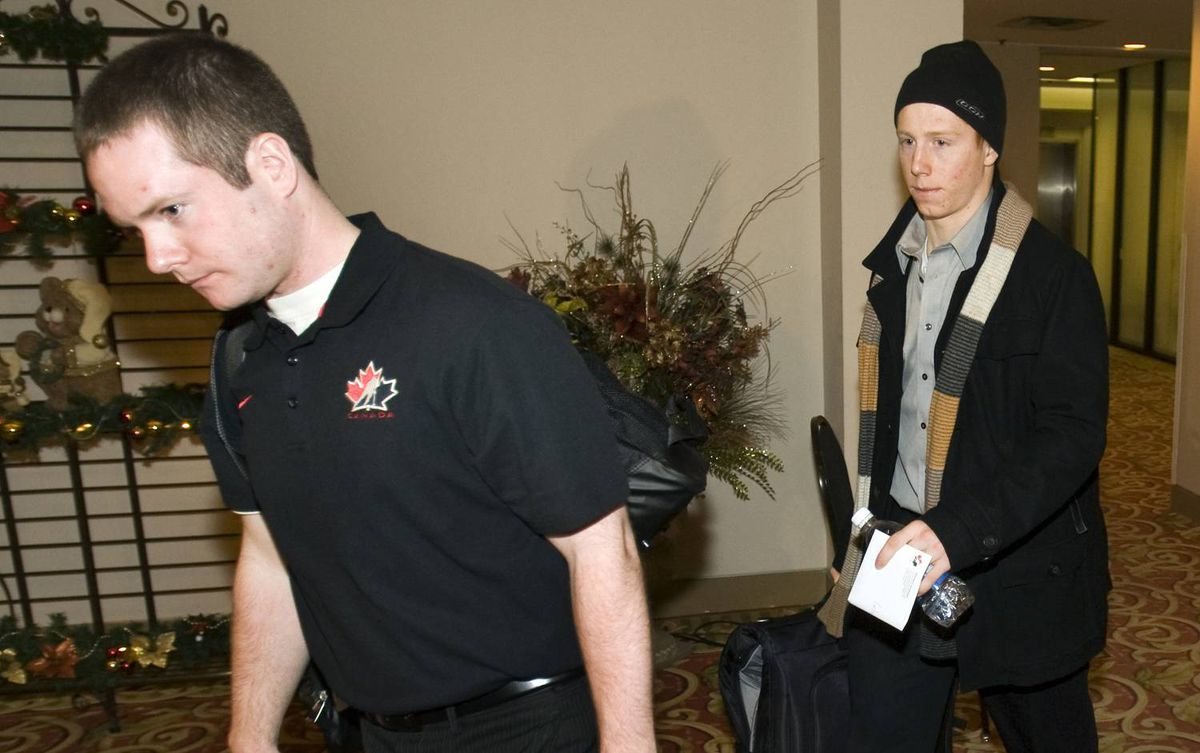 Forward Cody Eakin, right, from the Swift Current Broncos, is escorted by team media relations assistant Paul Krotz after being cut from the Canadian national junior team selection camp for the World Junior Ice Hockey Championships Wednesday, December 16, 2009, in Regina.