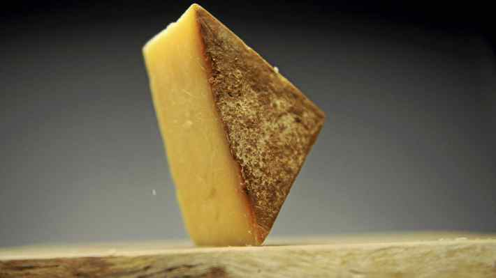 A wedge of Fiscalini Farmstead 18 month cheddar cheese