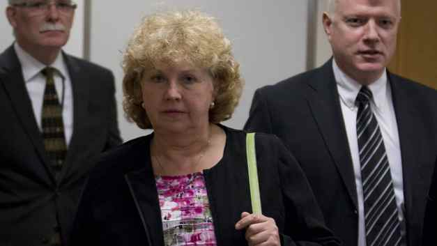Randi Connor, the Crown counsel who entered a stay of proceedings in January, 1998, for charges related to an alleged attack involving Robert Pickton one year earlier makes her way into testify at the missing woman's inquiry in Vancouver on April 10, 2012.