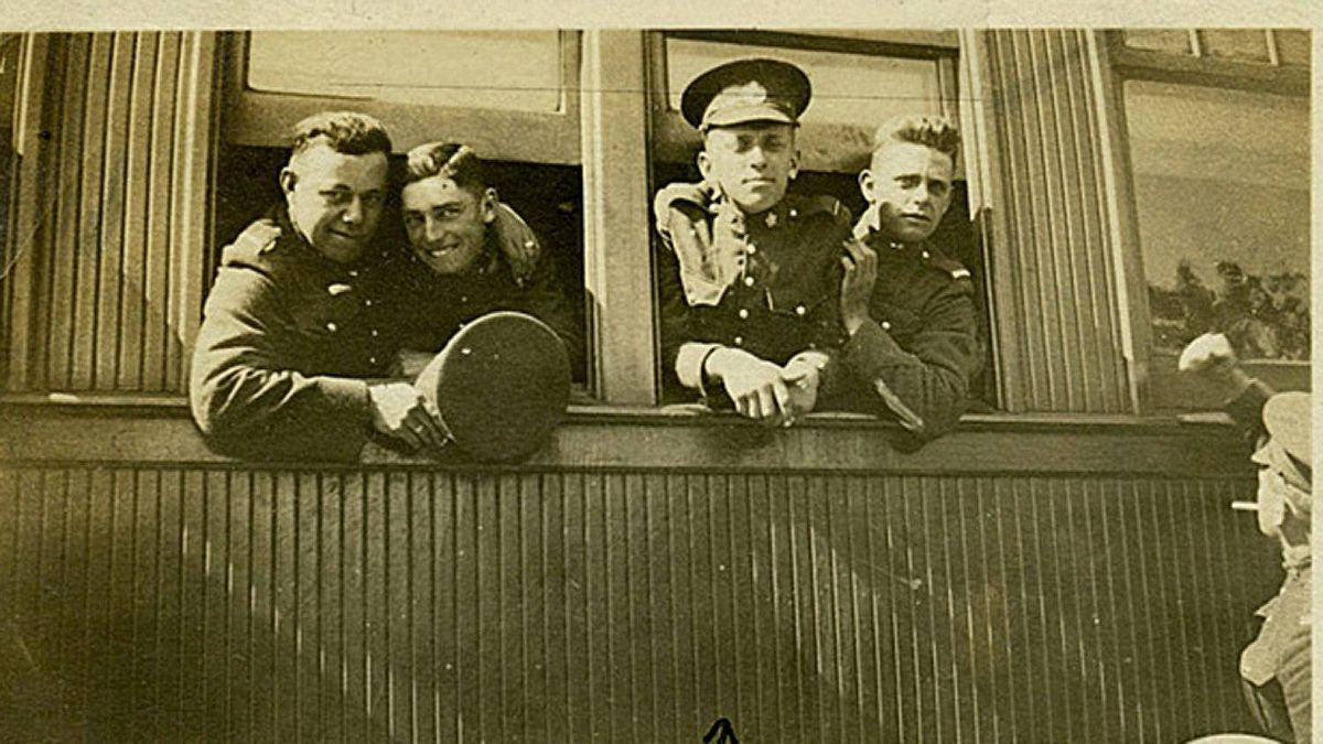 Donald Maynard (second from right) is pictured here shipping out to England on the train. He came from a farming family near Chatham, Ont. He was killed on October 25, 1918.