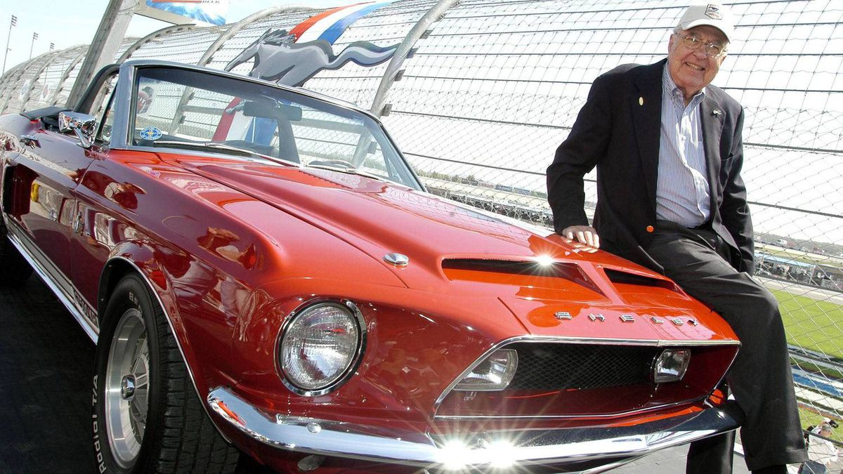 Carroll Shelby sitting on a 1968 GT500 KR during a celebration at the Nashville Super Speedway to mark the 40th anniversary of the Ford Mustang.