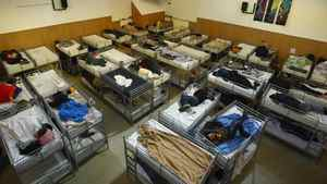Homeless people sleep in double-bunk beds in the former chapel of the First United Church on the Downtown eastside of Vancouver April 27, 2010.