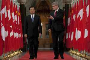 Prime Minister Stephen Harper, right, and Chinese President Hu Jintao walk through the Hall of Honour on Parliament Hill in Ottawa. Adrian Wyld/The Canadian Press