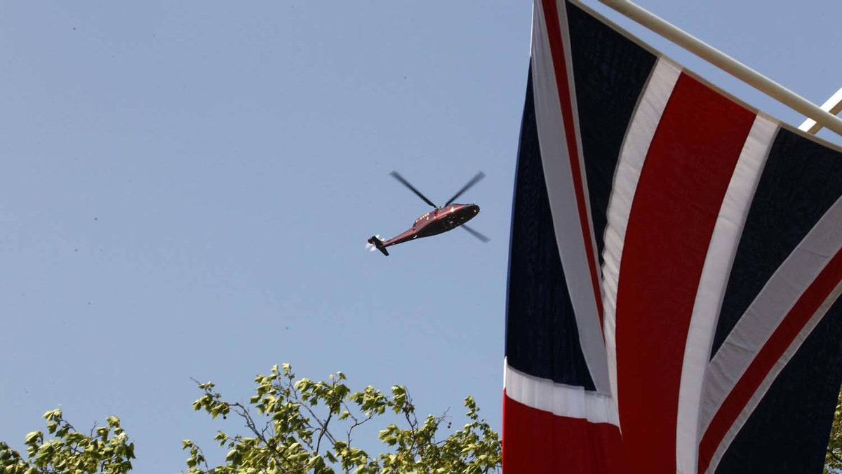A helicopter ferries Prince William and Catherine, Duchess of Cambridge, from Buckingham Palace to an undisclosed U.K. destination Saturday morning. The couple announced they will not be going on their honeymoon immediately, and that Prince William will return to work next week as a search and rescue pilot in Wales.