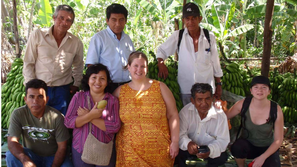 La Siembras Jennifer Williams (CEO) and Melanie Broguet (Marketing Project Manager) with CEPICAFE cocoa producers in Buenos Aires, Peru.