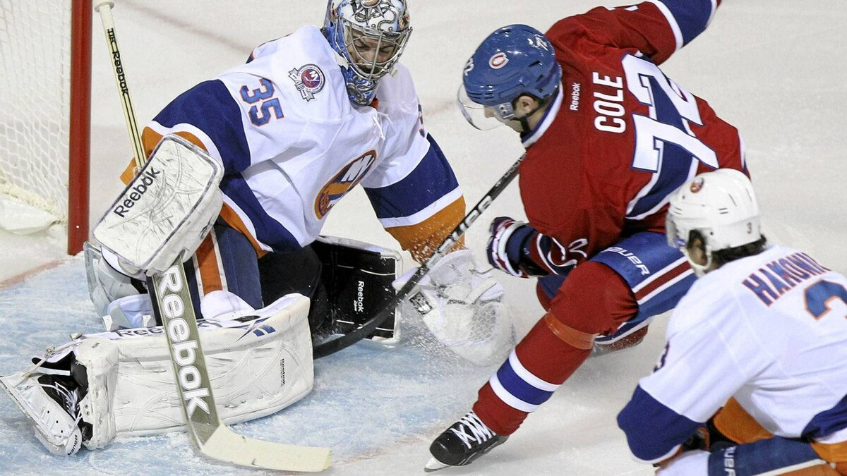 New York Islanders' goalie Al Montoya stops a shot by Montreal Canadien Erik Cole during the first period in Montreal.