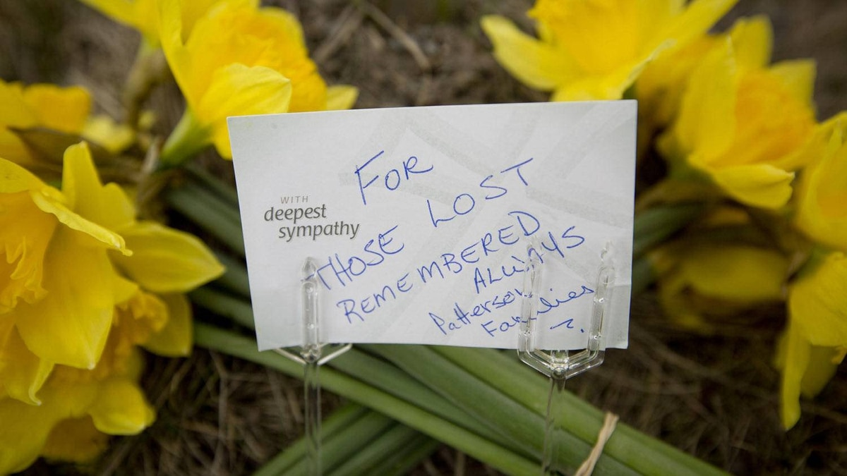 Flowers outside Lakeland Sawmill in Prince George April 25, 2012, to remember the two who died after a fire and explosion at the mill.