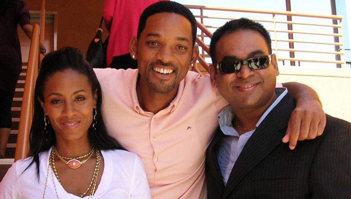 DeCosta Marketing's Jesse Decosta, right, with actor spouses Jada-Pinkett Smith and Will Smith