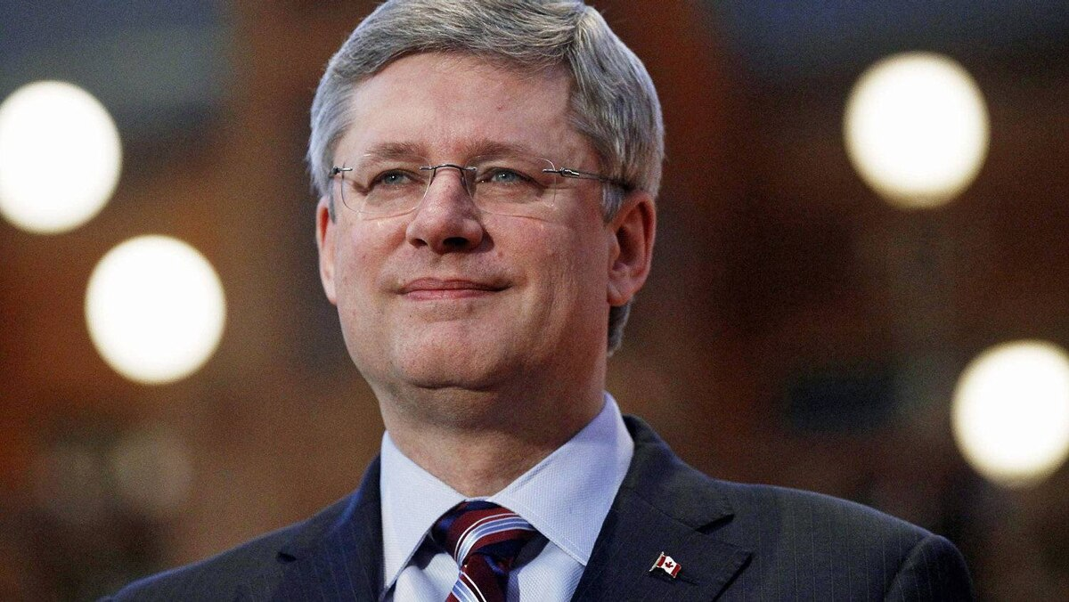 Prime Minister Stephen Harper grins during a photo-op at the Library of Parliament on Feb. 28, 2011.