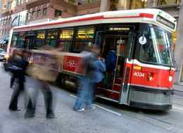 Passengers board a TTC streetcar; the TTC come under fire recently over rider photos and videos of what they deem unacceptable service.