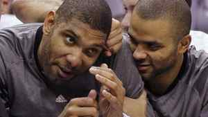 San Antonio Spurs centre Tim Duncan (L) and guard Tony Parker joke around on the bench at their game against the Utah Jazz during the second half of their NBA Western Conference quarter-final playoff basketball game in San Antonio, Texas April 29, 2012. The Spurs won 106-91. REUTERS/Mike Stone