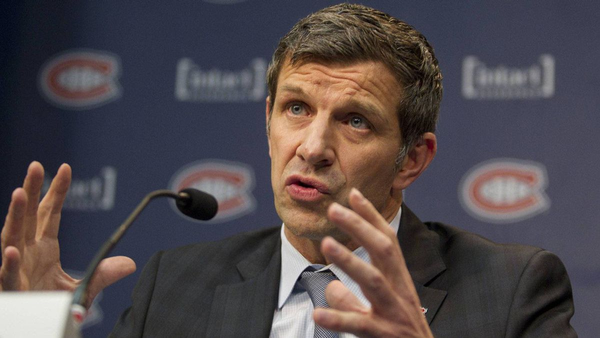 Marc Bergevin answers questions during a news conference which announces his appointment as the new general manager of the Montreal Canadiens NHL team in Brossard, Quebec, May 2, 2012.