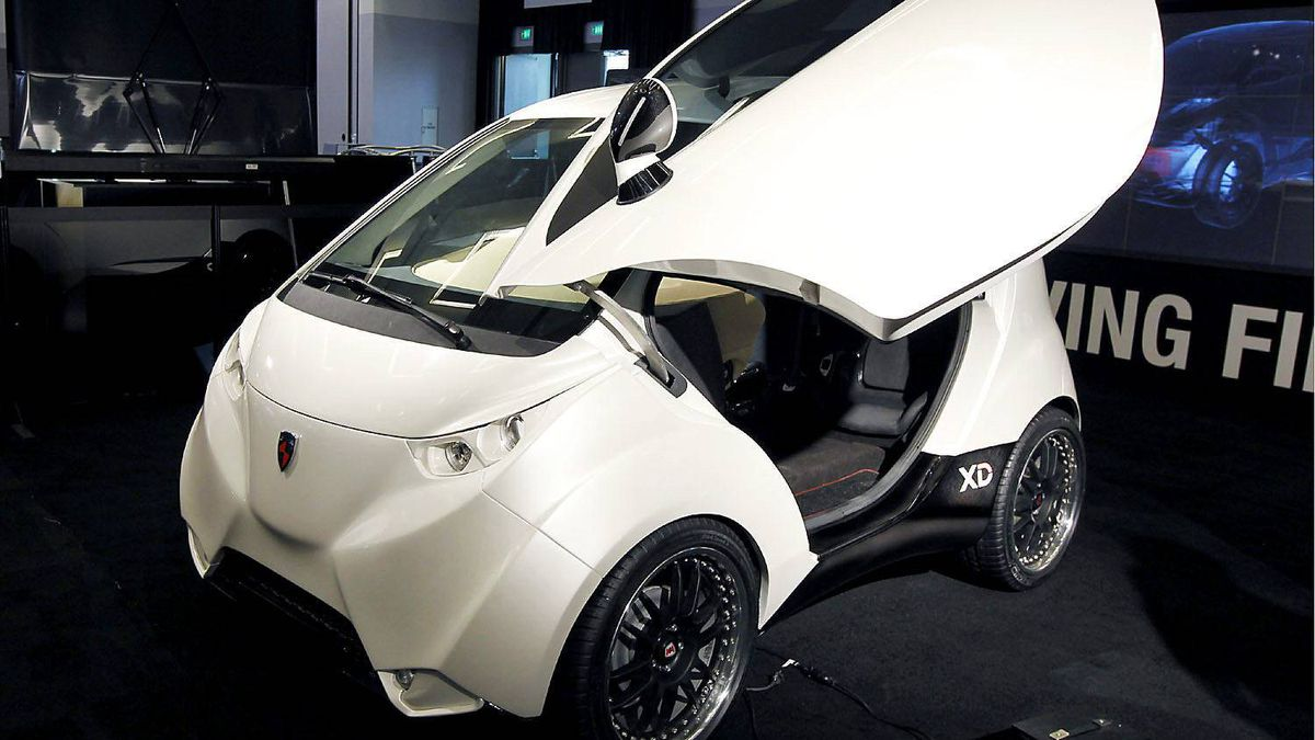 An electric city concept DOK-ING car is seen at the L.A. Auto Show in Los Angeles, California, November 17, 2011.