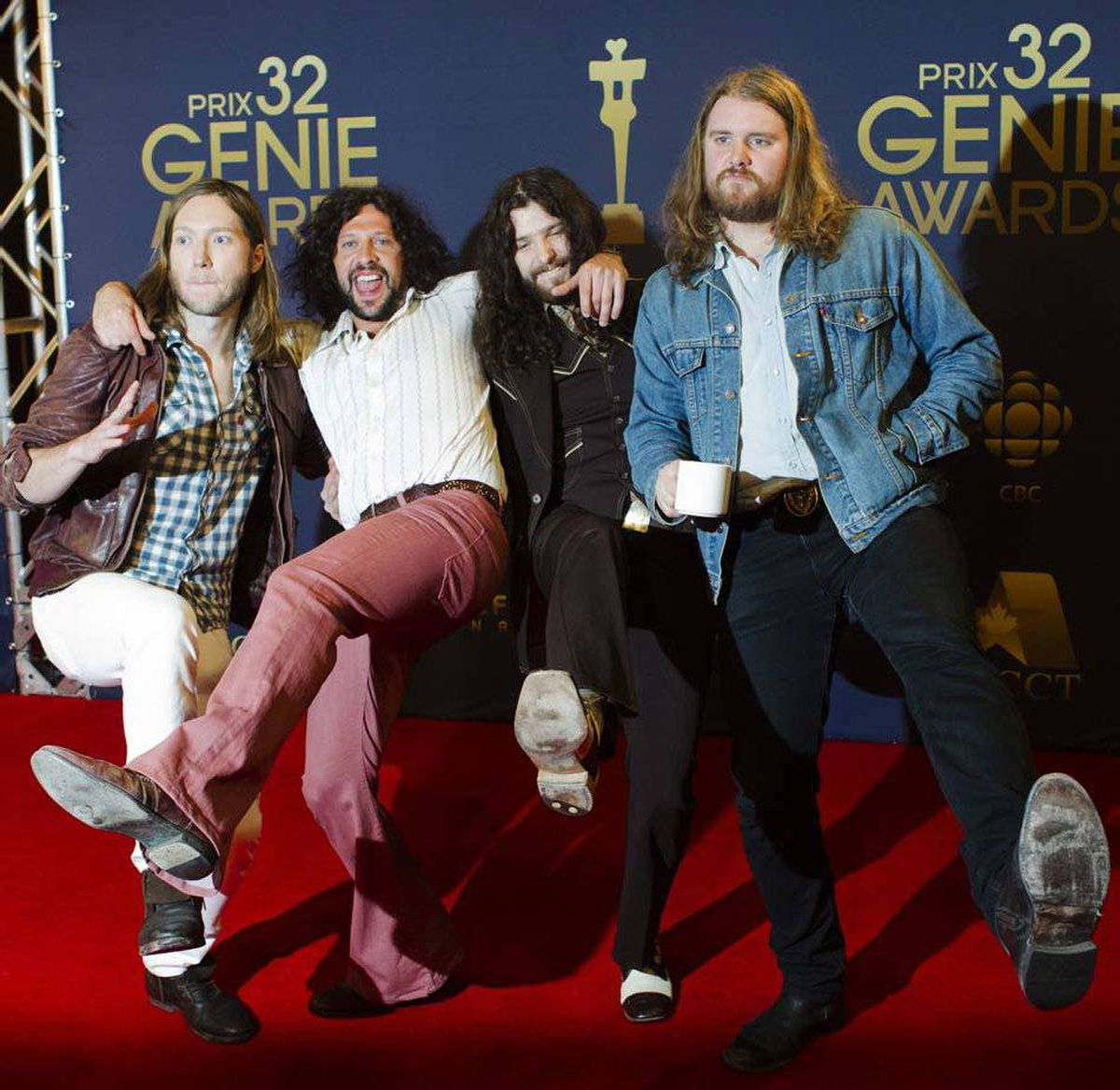 Members of the Canadian rock band The Sheepdogs dutifully act all irrepressible and outrageous at the Genie Awards in Toronto last week. Especially convincing is the dude on the right with one hand in his pocket and the other holding a cup of decaf.