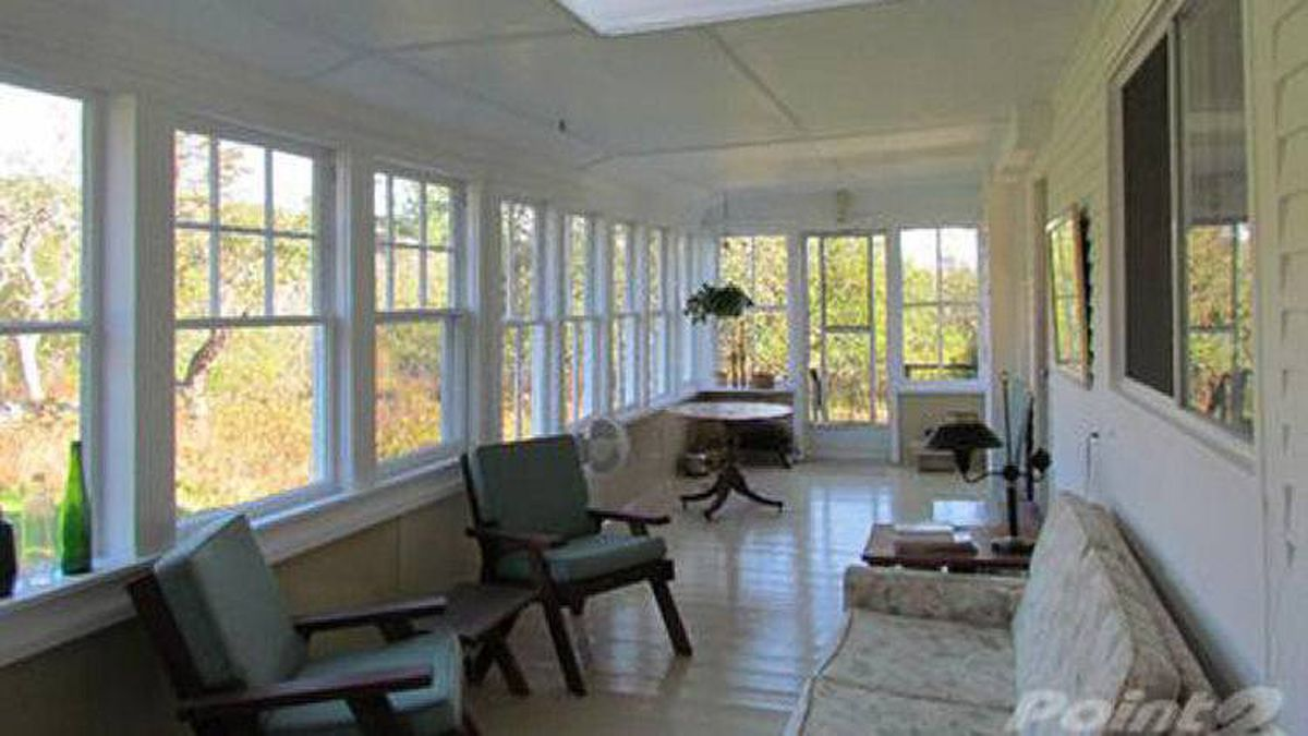 A glassed-in porch provides lots of light and extra living space.