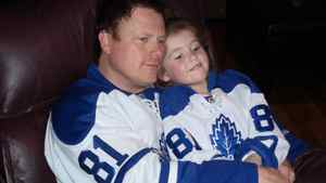 PropertyGuys.com Inc. co-founder and hockey memorabilia collector Ken LeBlanc watches, appropriately enough, a hockey game with his daughter, Isabelle, 5, at their Moncton home. Both are sporting Leafs jerseys bearing No. 81, which belongs to leading goal scorer Phil Kessel.