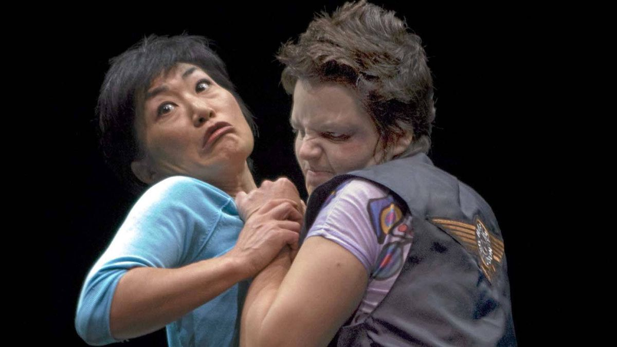"""Cast members Jean Yoon (left) and Michaela Washburn (right) perform a scene from Tomson Highway's play """"The Rez Sisters"""" in Toronto, Ont. on Nov. 8, 2011."""