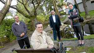 (L-R) Yousef Mohammadi, Carlos Ruiz, Kevin Anjam, and Kasia Gagnon pose for a portrait in the courtyard of their condo complex in North Vancouver on April 9th, 2012. The tenants were part of a group who contributed to a court decision to block the sale of their complex, known as Cypress Gardens, to a developer