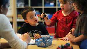 Teacher Nicole Abdool, left, works with students from left, Michael Fialho, 3, Alexis Gimnidis, 3, and Connor Cacoutis, 4, during a FasTracKids early learning program class in Thornhill, Ont.