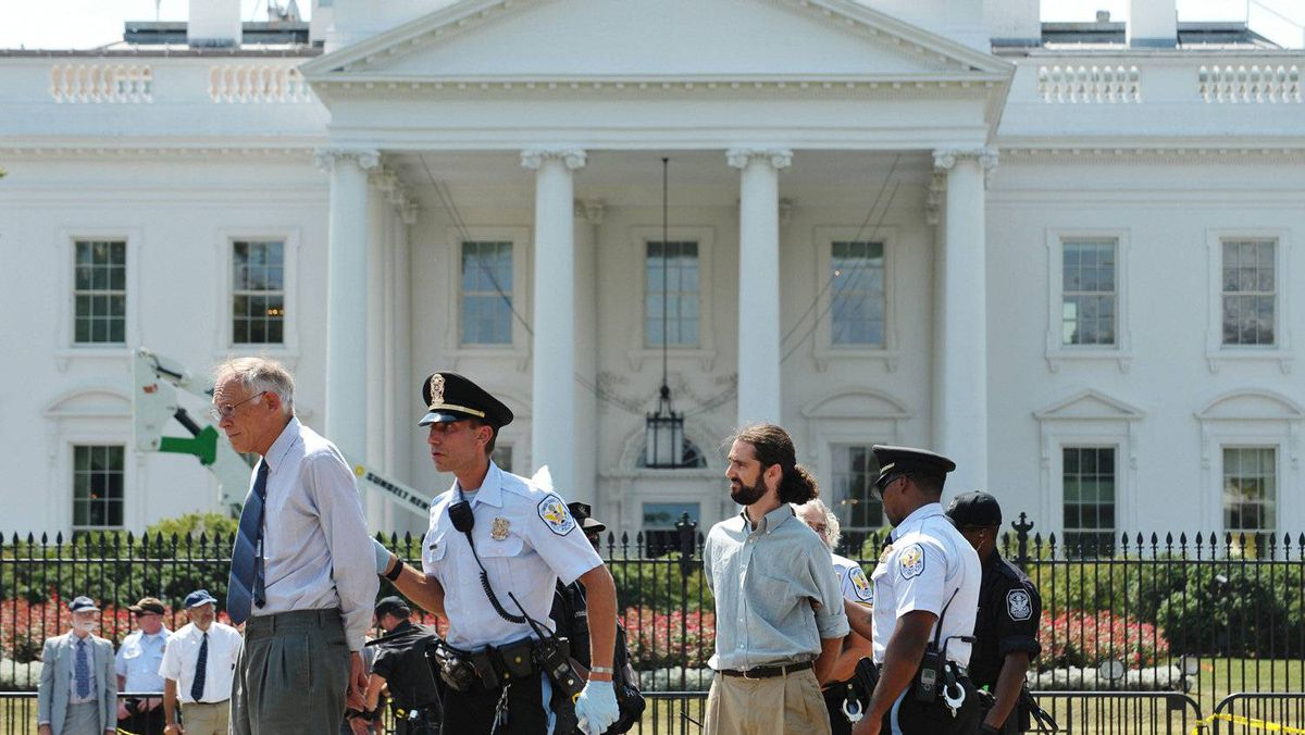 Police arrest protestors in front of the White House who were demonstrating against the Keystone pipeline.