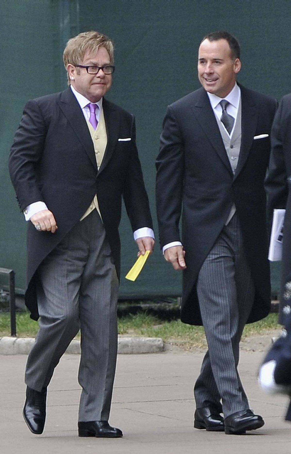 Elton John, left, and David Furnish arrive to attend the Royal Wedding of Prince William to Catherine Middleton at Westminster Abbey on April 29, 2011 in London, England.