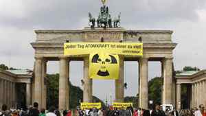 Greenpeace activists roll out a nuclear power protest banner atop the Brandenburg Gate in Berlin. The banner read: Every day with nuclear power is one day too much.