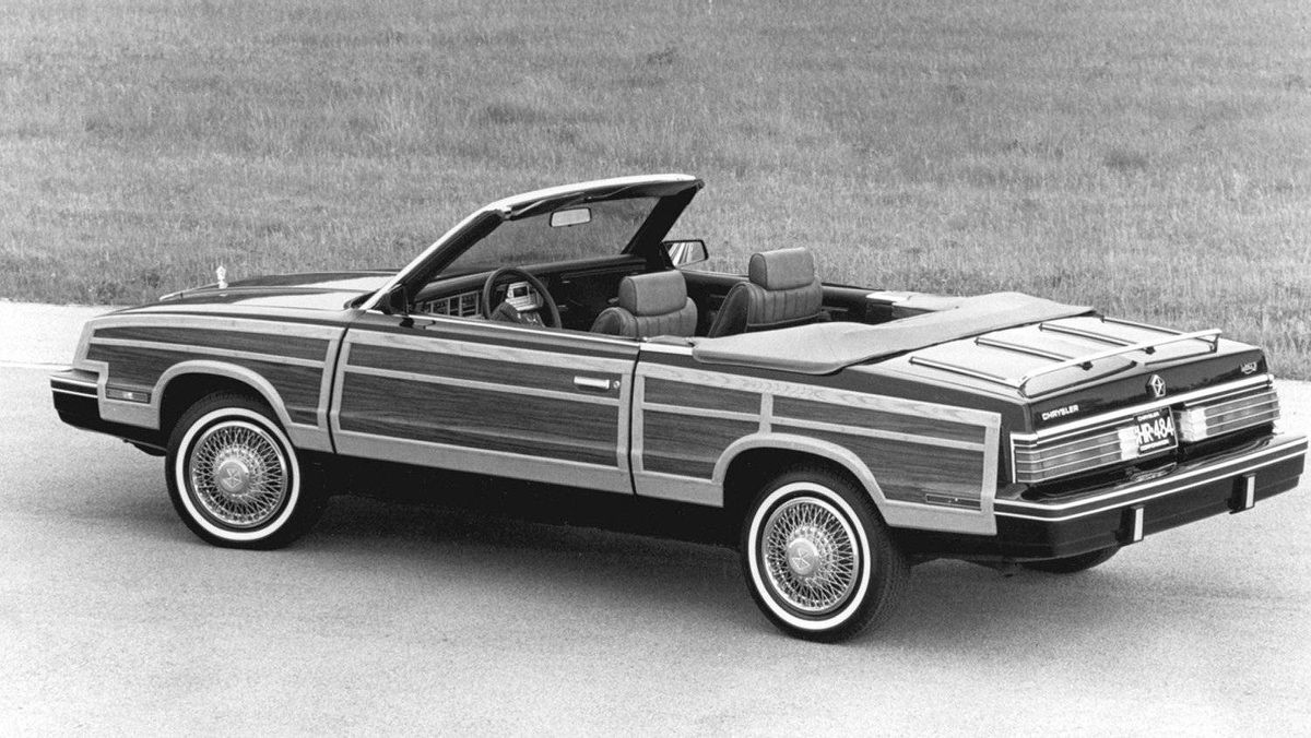 Not all convertibles are attractive. As evidence, I present the 1984 Chrysler LeBaron cabriolet with fake wooden side panels. As stylistic travesties go, this was hard to beat. On the upside, the top does come down.