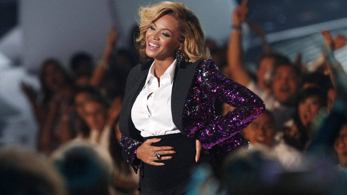 """Beyonce, who announced her pregnancy earlier in the day, rubs her stomach after performing """"Love On Top"""" at the 2011 MTV Video Music Awards in Los Angeles, August 28, 2011."""