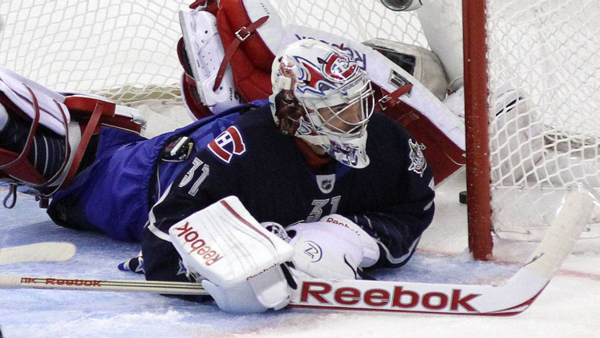 Team Chara goaltender Carey Price lies on the ice with the puck in the net on a goal by Team Alfredsson Jason Pominville during second period of the NHL All-Star game Sunday, January 29, 2012 in Ottawa. THE CANADIAN PRESS/Fred Chartrand