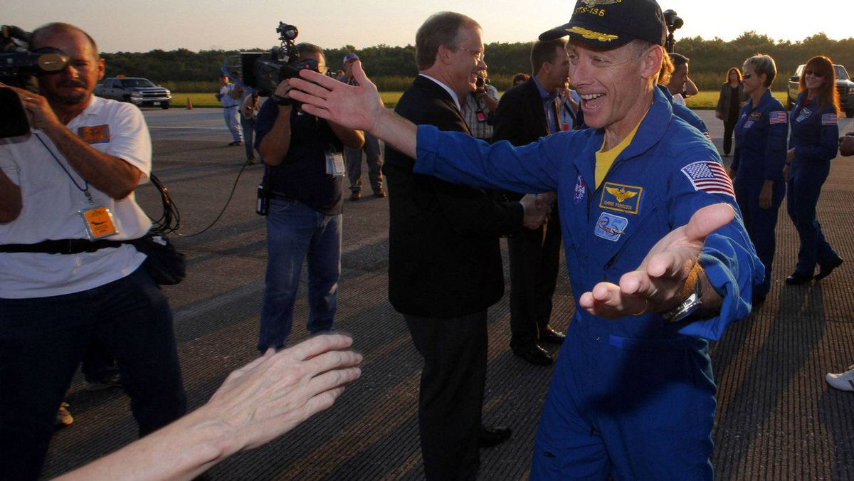 Space shuttle Atlantis Mission Commander Chris Ferguson (R) is greeted after landing at the Kennedy Space Center in Cape Canaveral, Florida, July 21, 2011.