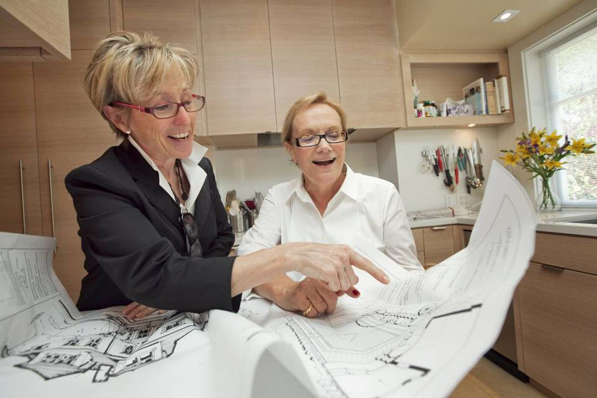 Home Renovation How Much To Spend And Where The Globe Mail Average Cost Of Rewiring A House Canada Architect Martha Dorion Discusses Renovations With Her Client Louise Wickson In Recently Renovated Kitchen