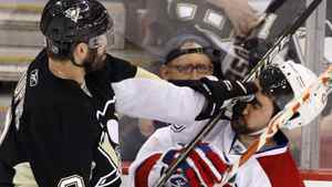 Pittsburgh Penguins' Pascal Dupuis (9) collides with Montreal Canadiens' Ryan O' Byrne during the first period of Game 1 of a second-round NHL playoff hockey game in Pittsburgh, Friday, April 30, 2010. (AP Photo/Gene J. Puskar)