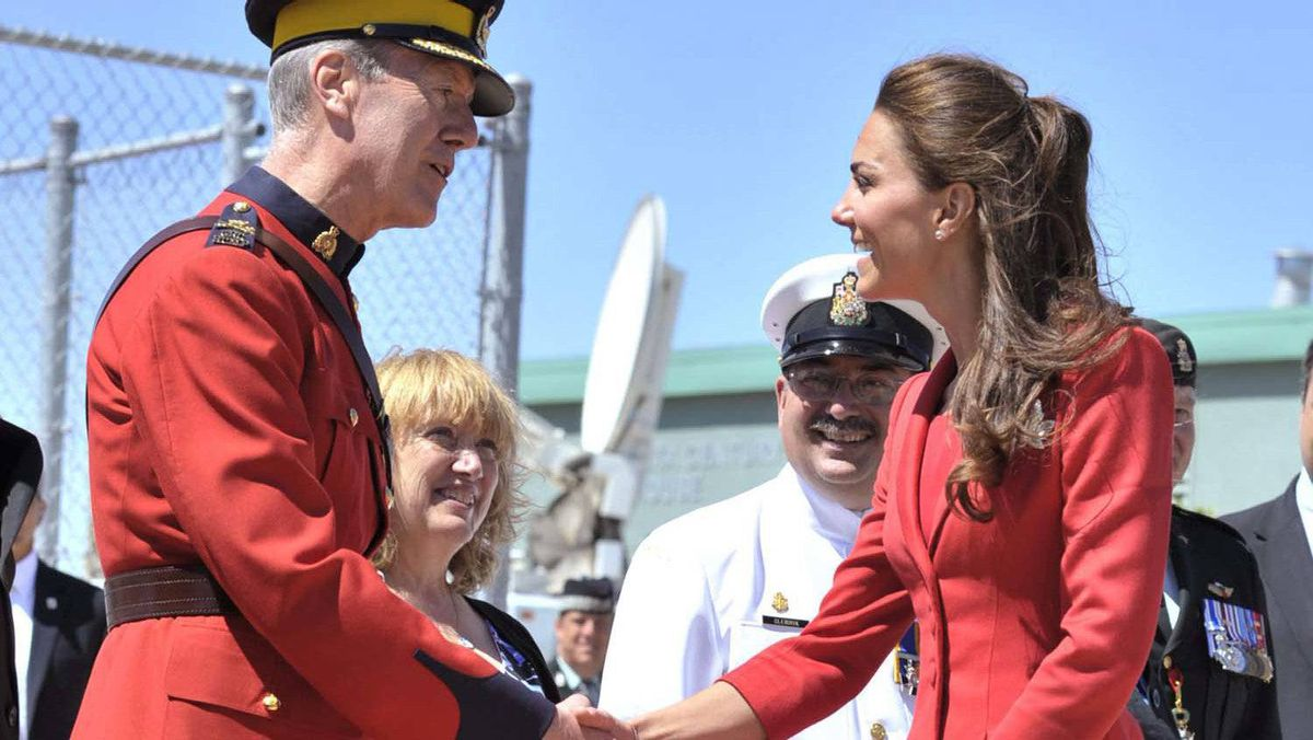 The Duchess of Cambridge is greeted by RCMP Deputy Commissioner Peter German at the official departure ceremony in Calgary, July 8, 2011.