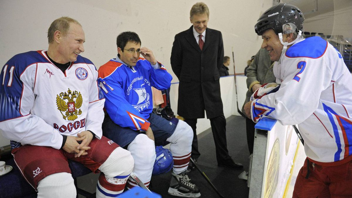 'During a break in the game, Viacheslav Fetisov spoke at length about the state of hockey in Russia and North America,' Stackhouse said. Fetisov, right, wore a Red Army uniform, the team he played for in the old Soviet Union before heading to the NHL in 1989. 'He is trying to rebuild his country's hockey culture, at the minor and professional level. He's also working on the NHL to allow its players to participate in the 2014 Olympics in Sochi. Before our chat, he spent part of the evening giving private lessons to Putin, focusing on his carves and quick shots.'